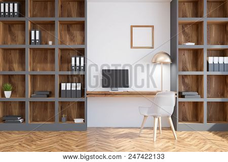 Interior Of A Home Office Interior With White Walls, A Computer Table With A Small Square Poster And