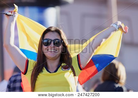 ST. PETERSBURG, RUSSIA - JUNE 28, 2018: Colombian football fans at FIFA Fan Fest in Saint Petersburg during the FIFA World Cup 2018 match Colombia vs Senegal. Colombia won 1-0