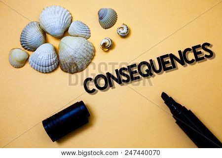 Conceptual hand writing showing Consequences. Business photo text Result Outcome Output Upshot Difficulty Ramification Conclusion Yellow background shadow open marker shells beach memory memories poster