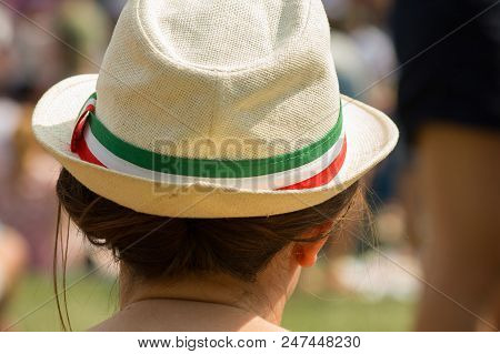 Young Woman With Straw Hat In Summer On A Music Festival.