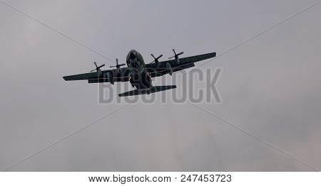 Taipei, Taiwan - Dec 23, 2015. A Lockheed C-130 Hercules Landing At Airbase In Taipei, Taiwan. C-130