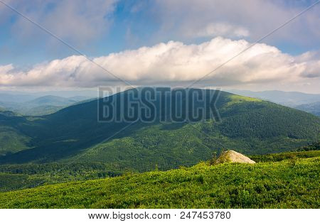 Landscape With Rocks On Grassy Alpine Hillside Of Carpathian Mountain Ridge. Gorgeous View Of Poloni