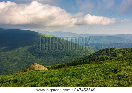 Green Hill Of Polonina Runa In Summer. Fine Weather With Some Clouds On A Blue Sky In Mountainous La
