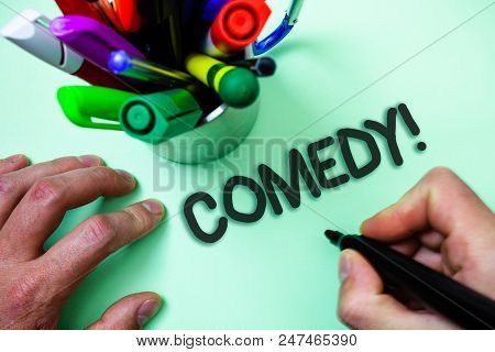 Text sign showing Comedy Call. Conceptual photo Fun Humor Satire Sitcom Hilarity Joking Entertainment Laughing Man holding black marker white background markers intention communicate poster
