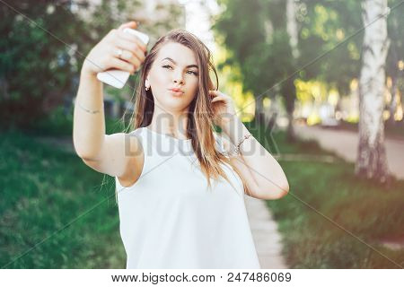 Young Beautiful Woman, Teenager, Making Selfie In Park