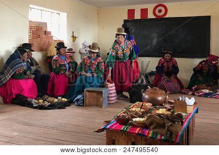 Puno, Peru - June 2018: Village Women From Iskapataza Altiplano Community Having Lunch In Their Dini