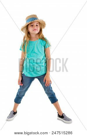 Confident Little 6 Year Old Girl In A Trendy Summer Outfit Standing With Spread Legs Looking Off To