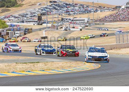 June 24, 2018 - Sonoma, California , USA: Kyle Larson (42) Races through turn ten at the TOYOTA/SAVE MART 350 at Sonoma Raceway in Sonoma, California .