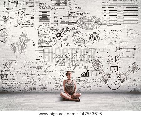 Young Girl In Front Of A Wall Full Of Drawn Math Formulas