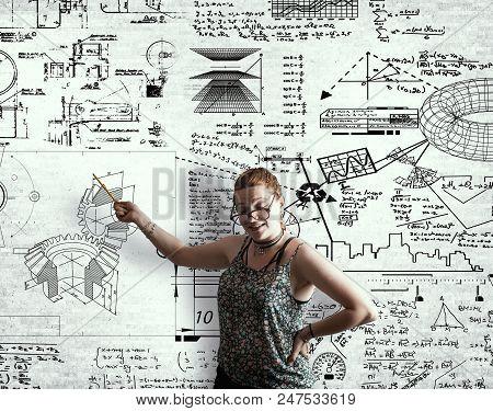 Young Girl In Explain Math Formula Wrriten On Wall.
