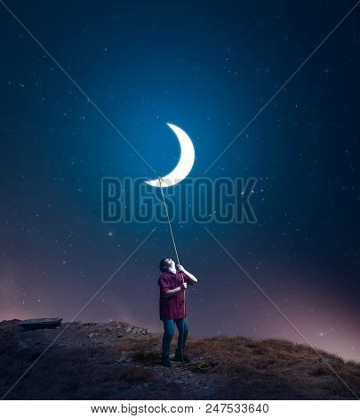 Kid Drag The Moon Towards Him With A Rope In The Middle Of The Night. The Concept Of Accomplish His