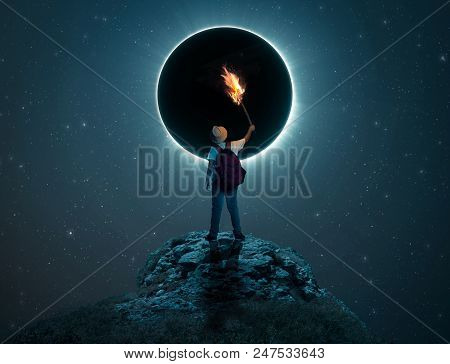 Traveler Kid Holding A Torch On A Peak In Front Of  Eclipse.