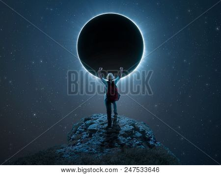 Traveler Kid Rising His Hands On A Peak In Front Of  Eclipse.