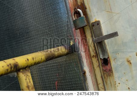Closed And Locked Door In Abandoned Industrial Area