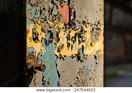 Cracked And Aged Layers Of Paint On An Iron Supporting Beam Of An Abandoned Industrial Building