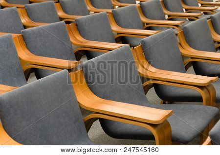 Elegant Empty Grey Chairs Neatly Ordered In Several Rows