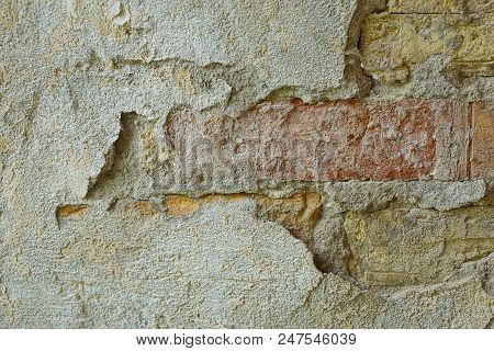 Stone Texture Of Gray Plaster And Bricks On The Wall Of The House