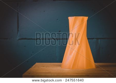 Bright Red Object Vase Printed By 3d Printer On Blue Brick Wall Background. Automatic Three Dimensio