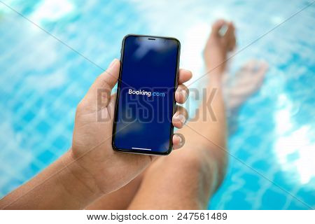 Koh Samui, Thailand - March 22, 2018: Man Hand Holding Iphone X With Application Booking.com Online