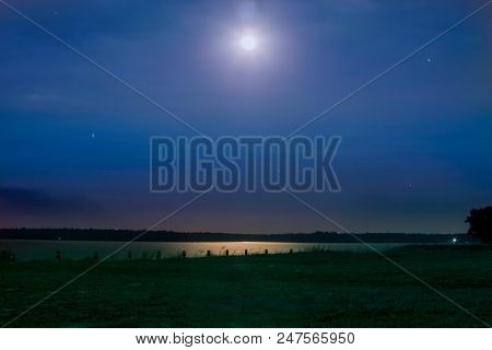 Beautiful Night Starry Landscape. Stars Reflected In The Water At Night. Astrophotography. Clear Sta