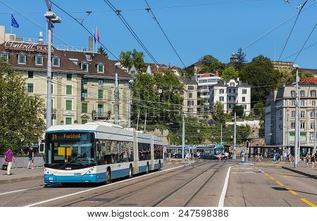 Zurich, Switzerland - June 30, 2018: A Hess Trolleybus Passing Along Bahnhofbrucke Bridge, Central S
