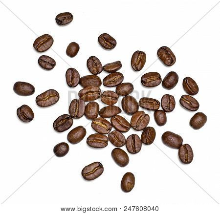 Roasted Coffee Beans, Isolated On White Background. Close-up Shot Of Delicious Arabica Beans, Pile O