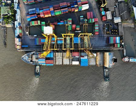 Aerial View Of Cargo Ship, Shipping Containers By Cargo Ship On The Chao Phraya River In Thailand