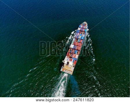 Aerial View Of Cargo Ship, Shipping Containers By Cargo Ship On The Sea