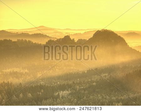 Spectacular Aerial View Of Hilly Silhouettes And Misty Valleys. Misty Awaking Of Beautiful Fairy Val