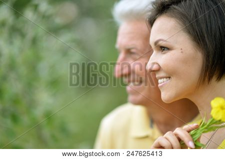 Smiling Young Woman With Senior Man Outdoors