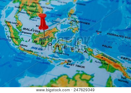 Pins On The Map Close Up To Borneo. Soft Focus