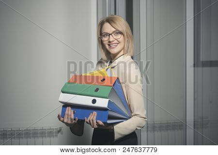 Business Woman Smile With Business Papers. Sexy Secretary With Piles Of Documents. Happy Woman Hold