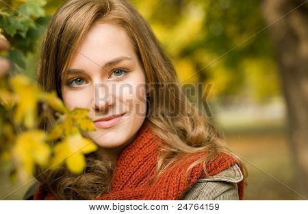 Beautiful Fashionable Brunette In The Park.