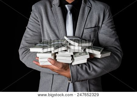 Man Holding Money In Hand At Black Background, Man Receive A Lot Money From Trading, Business Succes