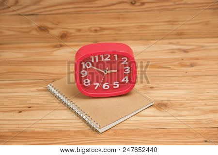 Business And Finance Concept Of Office Working, Closeup Blank Notebook And Clock On Desk In Working