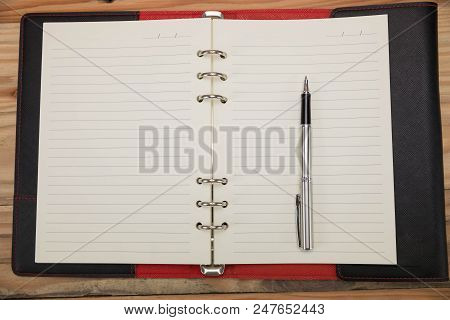 Business And Finance Concept Of Office Working, Closeup Blank Notebook And Pen  On Desk In Working D