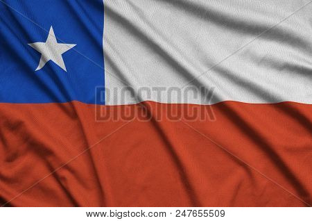 Chile Flag  Is Depicted On A Sports Cloth Fabric With Many Folds. Sport Team Waving Banner