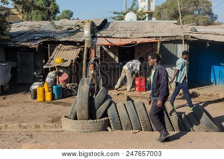 Addis Ababa, Ethiopia, January 30, 2014, Tire Salesman On A Busy Street With Various Informal Shops