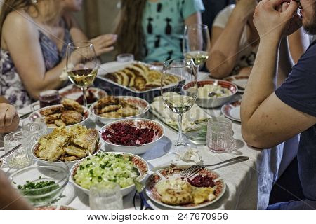 Big Family At Big Table Eating Verious Food Together. Gathering Or Celebration Concept, Birthday, Th