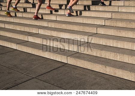 Group Of Jogger Running Upwards Stairs - Outdoor Fitness Training