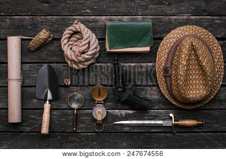 Gold Ore, Compass, Loupe, Dagger, Handgun, Diary Book, Shovel, Rope And Old Scroll Document On Adven
