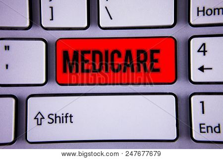Conceptual hand writing showing Medicare. Business photo text Federal health insurance for people above 65 or with disabilities Keyboard office typing work click assign button computer program poster