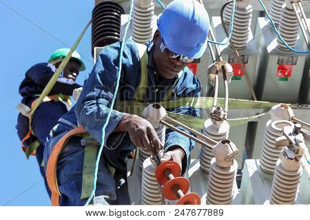 Johannesburg, South Africa, 04/11/2012, Electricians Working On High Voltage Power Lines. Highly Ski