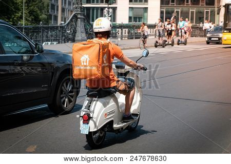 Berlin, Germany - June 2018: A Food Delivery Driver From  Lieferando, A Food Delivery Company, On Sc