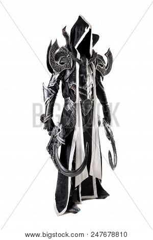 Man in a fantasy costume of a dark demon, cosplay, isolated in white poster