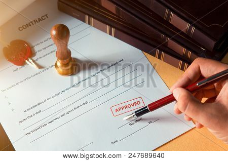 Notary Signing A Contract With Fountain Pen