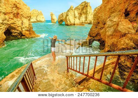 The End Of Staircase That Leads Ponta Da Piedade. Pier For Small Boats For Sightseeing Between Arche