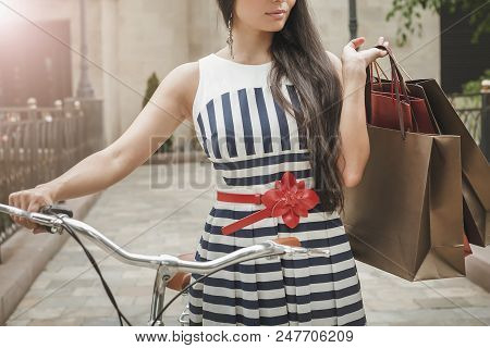 Fashion Woman Dressed In Striped Dress With Bags And Vintage Bike Has Shopping Travel To Italy, Mila