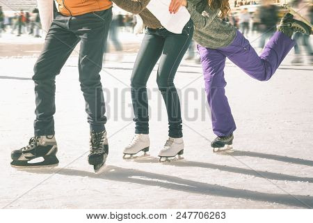 Image Of Ice-skaters Group Funny Teenagers. Ice Skating Outdoor At Ice Rink, Looking At Camera. Ice-
