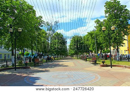 Gomel / Belarus - May 20, 2018 : Street Of Belarusian City Of Gomel With Benches Trees And Hanging G